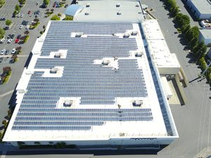 Drone shot of roof covered in solar panels TPO single ply membrane at Kohl's roof in Petaluma.