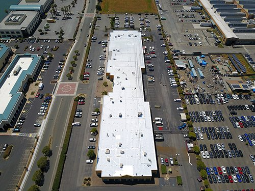 This is a photo of an 60,000 sq ft silicone restoration system we did in the Richmond Marina.