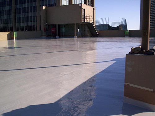 glossy concrete deck of parking structure